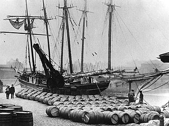 London Docks - Port wine from Oporto being unloaded on a London Docks quayside, circa 1909.