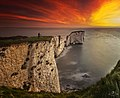 Lone Photographer Watching Sunrise Over Old Harry Rocks (21627483940).jpg