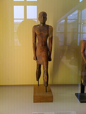 Kouros - Saite sculpture from the 26th dynasty similar in proportion and form to the early kouros type, Louvre E5345.