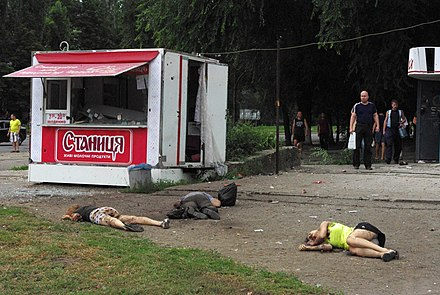 "Civilians killed in shelling in eastern Ukraine. According to the HRW report, ""The use of indiscriminate rockets in populated areas violates international humanitarian law, or the laws of war, and may amount to war crimes."" Lugansk-2014-06-18.jpeg"