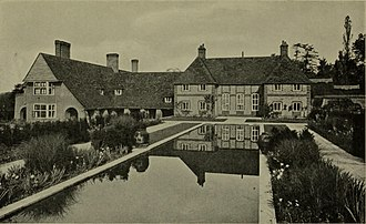 Folly Farm, Sulhamstead - 1921 view of the south, garden front, showing the vernacular wing of 1912 (left), the William and Mary front of 1906 and the canal garden