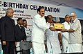 M. Venkaiah Naidu giving away awards for the best service at an event to rededicate Thakkar Bapa Vidyalaya (3).jpg