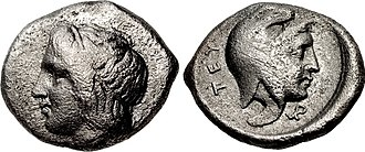 "Prokles (Pergamon) - Coin of Prokles, brother and co-ruler of Eurysthenes, as Dynast of Teuthrania and Halisarna, circa 400-399 BC. Obv: Head of Apollo. Rev: Portrait of Prokles wearing the Persian cap. Letters ΤΕΥ (""TEU"", for Teuthrania). Teuthrania, Mysia. Laureate head of Apollo left / Head of Prokles right, wearing Persian headdress."