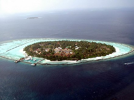 Island with fringing reef in the Maldives Maldives - Kurumba Island.jpg