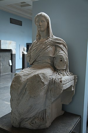 Hades and persephone statue on throne