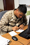 Marine corpsman assists with housing efforts at GTMO 130701-Z-FT114-003.jpg