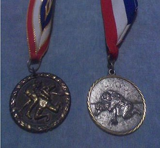 Amateur wrestling - An example of medals that are usually rewarded to the winner of a tournament.