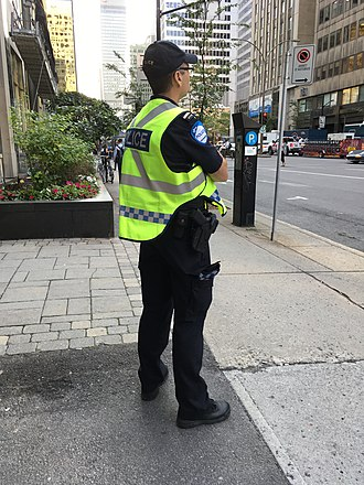 Police officer - Police officer on street patrol in Montreal, Canada