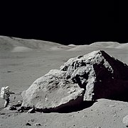 Schmitt stands next to a large boulder during EVA 3