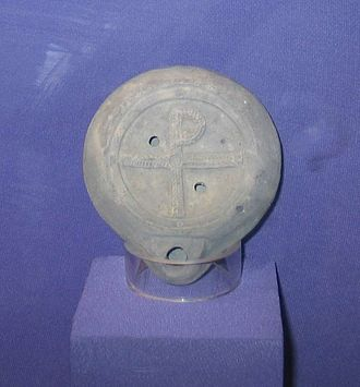 Staurogram - An oil lamp  with staurogram from Caesarea Maritima. Glass Factory Museum, Nahsholim, Israel.
