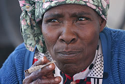 Nama Woman Smoking Kalahari Desert Namibia Luca Galuzzi 2004.JPG