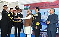 Narendra Modi presented Innovation trophies to awardees, during the 'At Home' reception, organised by the Chief of Naval Staff, Admiral R.K. Dhowan, on the occasion of Navy Day (2).jpg