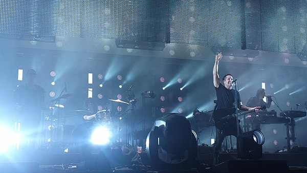 Nine Inch Nails performing in November 2013; from left to right: Pino Palladino, Ilan Rubin, Trent Reznor, and Alessandro Cortini Nine inch nails - Staples Center - 11-8-13 (10755555065 16053de956 o).jpg