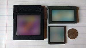 Game Boy Advance - Clockwise from left: A Game Boy Color game cartridge, a Game Boy Advance game cartridge, and a Nintendo DS game cartridge. On the far right is a United States Nickel shown for scale.