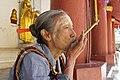 Nyaung-U, Bagan, Myanmar, Smoking in Buddhist temple.jpg