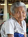Old woman of Don Puay grey hair wrinkled skin twisted back.jpg