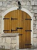 Old wooden medieval door in the old town of Kotor Montenegro.jpg