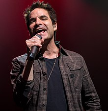 Monahan performing with Train in 2014.