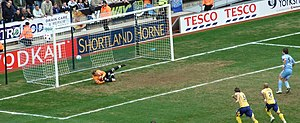 Gareth McAuley - McAuley (No. 5) watches as Coventry score a penalty kick in an M69 derby at the Ricoh Arena