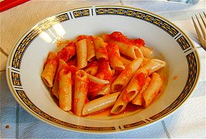 Tomato sauce - Penne pasta served with tomato sauce.