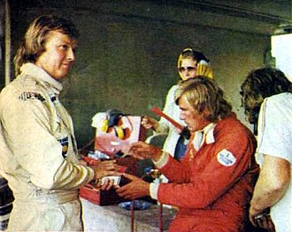 1975 Austrian Grand Prix - Ronnie Peterson (left) and James Hunt in the pits