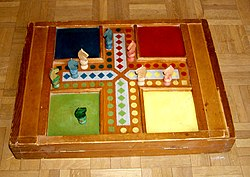 A game of Petits-Chevaux (Small Horses), a French alternative of Parcheesi and Ludo
