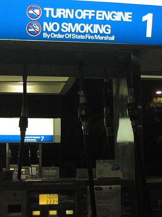 "Fire marshal - A ""no smoking"" sign at a gas station by order of the state fire marshal. The fire marshal is often charged with enforcing fire-related laws."