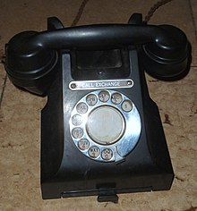 telephone with letters on its rotary dial 1950s uk