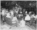"""Photograph of President Truman holding a press conference on the lawn of the """"Little White House,"""" his vacation... - NARA - 200495.tif"""