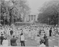 Photograph of a crowd of spectators in Lafayette Park north of the White House (those in uniform saluting) on the... - NARA - 199177.tif