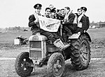 Pilots of No. 601 Squadron RAF use a tractor to negotiate muddy conditions on their airfield at Exeter, November 1940. CH17324.jpg