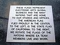 Plaque at base of EA HQ complex flags.JPG