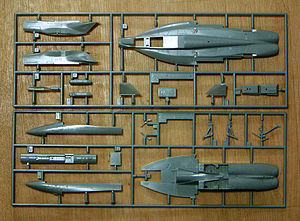 "Plastic model - Unassembled parts of a Hasegawa 1/72 F-18E kit. The frame surrounding the various parts is called the injection moulding ""sprue"""