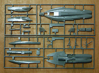 "Plastic model - Unassembled parts of a Hasegawa 1/72 F-18E kit. The frame surrounding the various parts is called the injection moulding ""runner"""