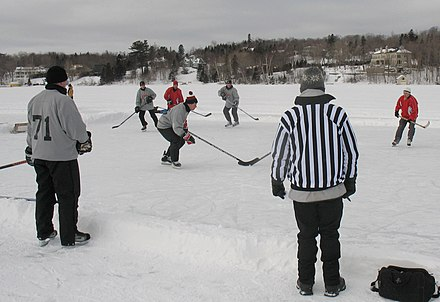 A game of pond hockey being played in Lac-Beauport, Quebec Pond hockey-LacBeauport2010-b.JPG