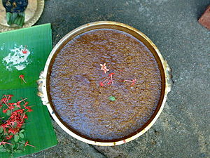 English: made with rice, jaggery and ghee. മലയ...