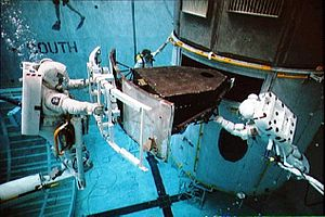 Wide Field and Planetary Camera - Astonauts practice replacing the WFPC on Earth in water tank to simulate working in space in 1993. That model being used is a full-scale training version of the WFPC
