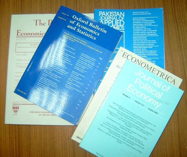 Different types of peer-reviewed research journals; these specific publications are about economics Research Journals.jpg