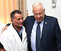 Reuven Rivlin with Afif Sitawe, the father of Haiel Sitawe who were killed in the shooting attack on the Temple Mount, July 2017 (1224).jpg