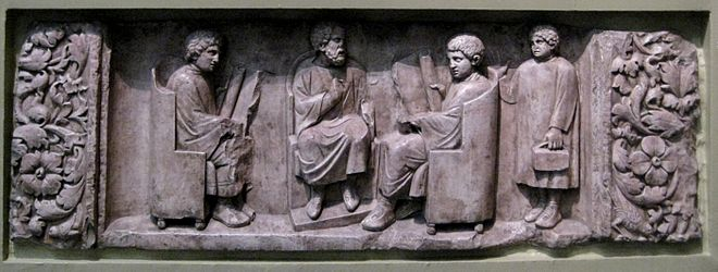 A teacher with two students, as a third arrives with his loculus, a writing case that would contain pens, ink pot, and a sponge to correct errors Roman school.jpg