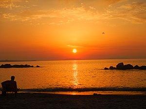 Rometta - the beach of Rometta facing cape Milazzo and Aeolian islands at the sunset.