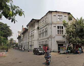 Kota Tua Jakarta - East facade of Cipta Niaga Building, formerly a bank office, has been left roofless and slowly deteriorates; the wooden interior exposed to the element.
