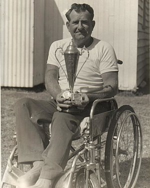 Australia at the 1964 Summer Paralympics - Roy Fowler holding a trophy and two medals that he won over his sporting career