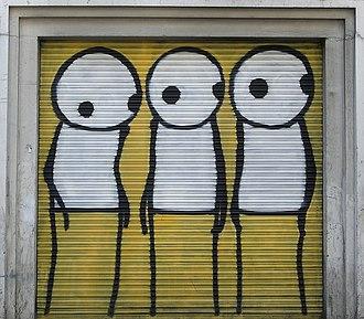 Stik - Stik's graffiti on a shopfront shutter in Shoreditch, London.