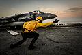 Sailor directs a Harrier II in the Arabian Gulf. (10476759385).jpg