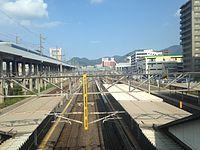 Sanyo Shinkansen and Kagoshima Main Line from overpass of Nishi-Kokura Station.JPG