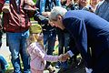 Secretary Kerry Shakes Hands With a Young Russian Girl After Visiting the Zavokzalny War Memorial.jpg