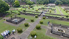 The Gardens of Shaniwar Wada are seen. The foundations of many structures as well as fountains are also present.