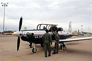 SHEPPARD AIR FORCE BASE, Texas -- Col. David Petersen, 80th Flying Training Wing commander, is greeted by Lt. Col. Andrew Toth, 80th Operations Group deputy commander, and Lt. Col. Ternell Washington, 80th FTW, Jan. 4. Colonel Petersen and Maj. Jeff Grayson, 97th Flying Training Squadron chief of training, traveled to Randolph Air Force Base, Texas, to retrieve the first T-6A Texan II's in Sheppard's inventory. (U.S. Air Force photo/Airman 1st Class Jacob Corbin)