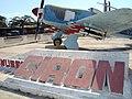 Sign and Warplane outside Museum - Playa Giron (Bay of Pigs) - Cuba (5289905976).jpg